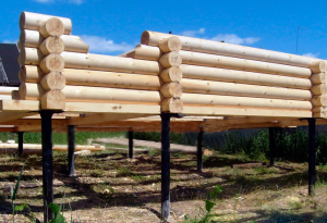 Свайный фундамент для дома из бревен
